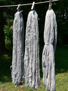 three pale woad dyed skeins