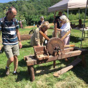 Gina at the scutching wheel